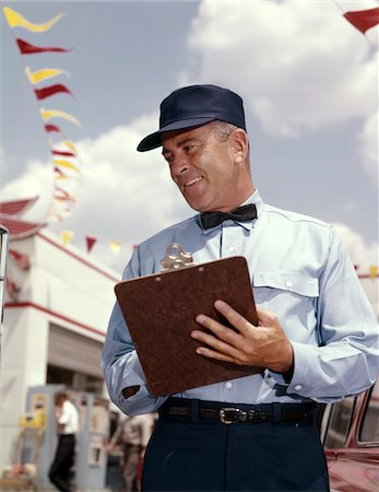 rural gas station - 1950s - 1960s MAN SERVICE MANAGER AT AUTOMOBILE GAS AND REPAIR SERVICE STATION WRITING ON CLIPBOARD Stock Photo - Rights-Managed, Code: 846-05647242