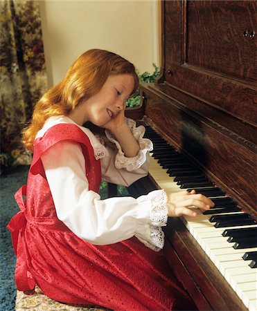 red hair preteen girl - 1980s GIRL WITH RED HAIR PLAYING PRACTICING THE PIANO Stock Photo - Rights-Managed, Code: 846-05647253