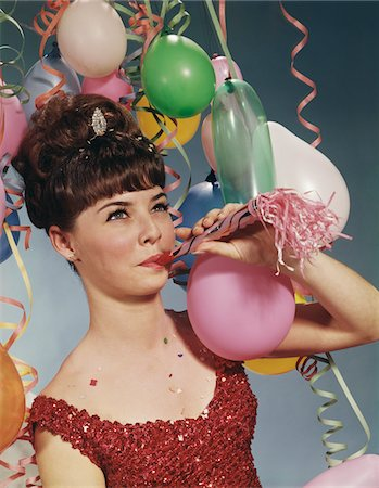 1960s WOMAN BLOWING NEW YEARS PARTY NOISEMAKER Stock Photo - Rights-Managed, Code: 846-05647266