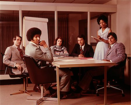 1970s BUSINESS MEETING SIX SERIOUS PEOPLE SITTING AROUND CONFERENCE TABLE Stock Photo - Rights-Managed, Code: 846-05647272