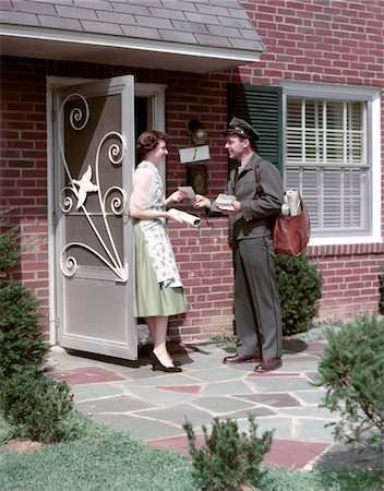 1950s MAILMAN DELIVERING MAIL TO WOMAN BRICK SUBURBAN HOME Stock Photo - Rights-Managed, Code: 846-05647308
