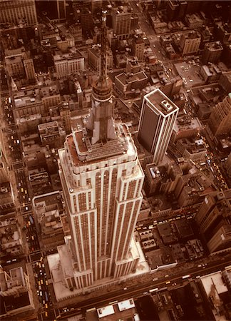 1970s AERIAL SHOT FROM HELICOPTER LOOKING DOWN FULL LENGTH OF EMPIRE STATE BUILDING MIDTOWN MANHATTAN NEW YORK CITY Stock Photo - Rights-Managed, Code: 846-05647366
