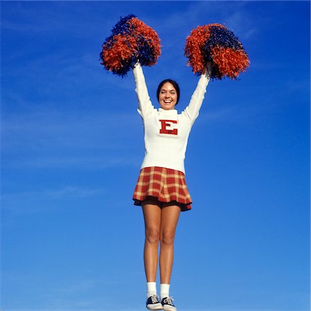 1960s - 1970s TEEN GIRL CHEERLEADER FULL FIGURE HEAD TO TOE SADDLE OXFORD SHOES PLAID SHORT SKIRT POMPOMS Y STANCE ARMS UP Stock Photo - Rights-Managed, Code: 846-05647404