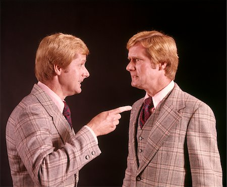 1970s ANGRY RED HAIRED MAN IN PLAID SUIT ARGUING WITH HIMSELF Stock Photo - Rights-Managed, Code: 846-05647409