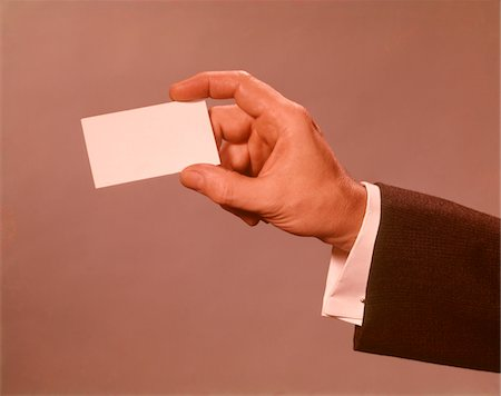 1960s - 1970s MAN HAND HOLDING BLANK BUSINESS CARD Stock Photo - Rights-Managed, Code: 846-05647453