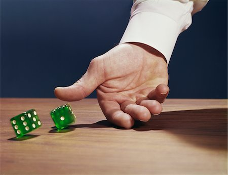 1960s MAN'S HAND ROLLING DICE Stock Photo - Rights-Managed, Code: 846-05647493