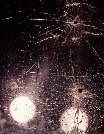 1970s BULLET HOLES AND RAINDROPS ON SHATTERED GLASS WINDSHIELD Stock Photo - Rights-Managed, Code: 846-05647511