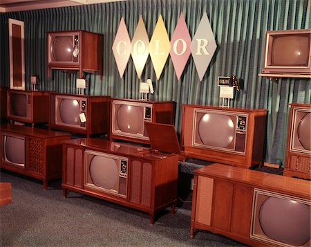 1960s DISPLAY OF COLOR TELEVISION SETS FOR SALE IN DEPARTMENT STORE Stock Photo - Rights-Managed, Code: 846-05647532