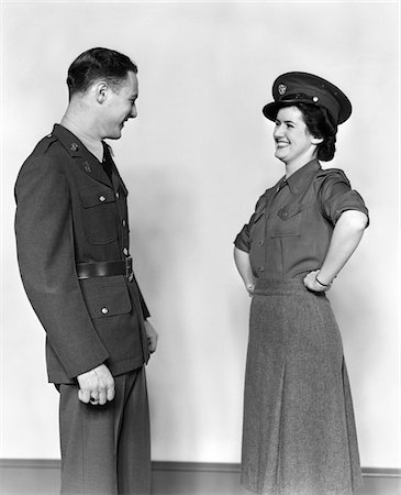 1940s COUPLE MAN IN UNIFORM WOMAN SMILING WEARING HIS HAT HANDS ON HIPS Stock Photo - Rights-Managed, Code: 846-05647660