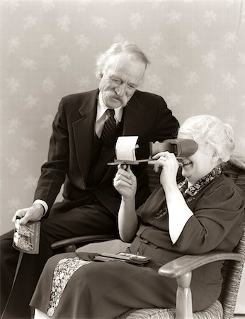 1940s OLDER SENIOR COUPLE MAN WOMAN VIEWING PHOTOGRAPHS BY STEREOPTICON STEREOSCOPE Stock Photo - Rights-Managed, Code: 846-05647785