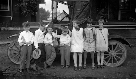 1910s CHILDREN LINED UP IN FRONT OF TRUCK FACING CAMERA Stock Photo - Rights-Managed, Code: 846-05647786
