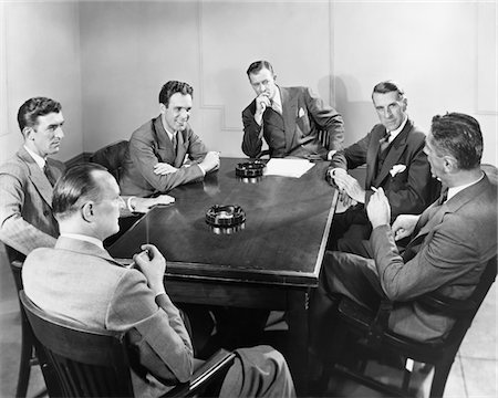 1930s - 1940s 6 BUSINESSMEN MEETING IN BOARDROOM AROUND TABLE WITH ASHTRAYS Stock Photo - Rights-Managed, Code: 846-05647797
