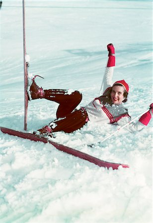 1940s - 1950s WOMAN ON SKIS FALLING IN SNOW Stock Photo - Rights-Managed, Code: 846-05647824