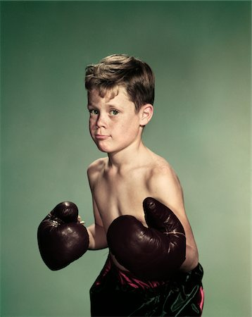 1940s - 1950s PORTRAIT BOY  WEARING BOXING GLOVES AND TRUNKS Stock Photo - Rights-Managed, Code: 846-05647855