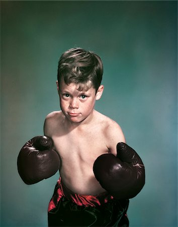 1940s - 1950s PORTRAIT BOY WEARING BOXING GLOVES AND TRUNKS Stock Photo - Rights-Managed, Code: 846-05647853