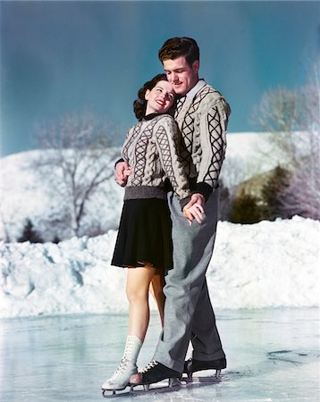 1940s - 1950s SMILING COUPLE ICE SKATING WEARING MATCHING SWEATERS Stock Photo - Rights-Managed, Code: 846-05647873