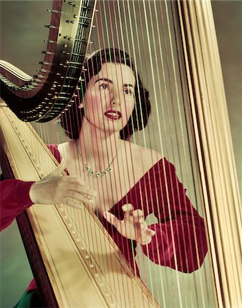 1940s - 1950s WOMAN PLAYING HARP WEARING RED VELVET GOWN Stock Photo - Rights-Managed, Code: 846-05647881