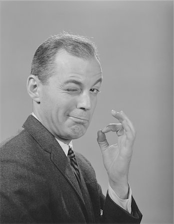 1950s - 1960s MAN WINKING EYE MAKING OKAY GESTURE SIGN WITH THUMB AND INDEX FINGER Stock Photo - Rights-Managed, Code: 846-05647894