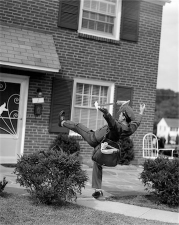 1950s MAN MAILMAN TRIPPING FALLING IN FRONT OF A SUBURBAN BRICK HOUSE ACCIDENT Stock Photo - Rights-Managed, Code: 846-05647905