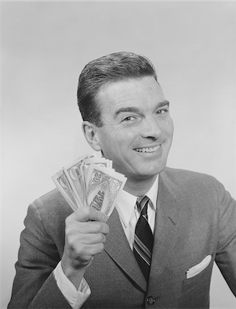 1950s - 1960s SMILING MAN HOLDING A FISTFUL OF MONEY FAKE BILLS Stock Photo - Rights-Managed, Code: 846-05647914