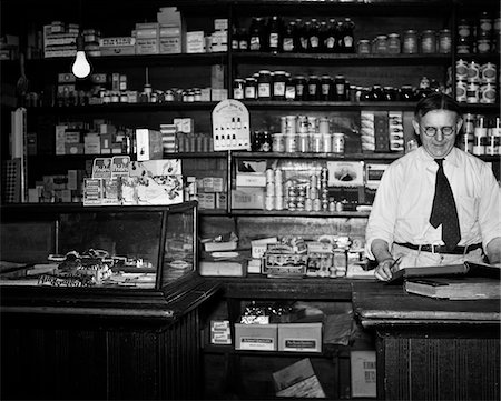 1930s GENERAL STORE INTERIOR GROCER OWNER BEHIND COUNTER Stock Photo - Rights-Managed, Code: 846-05647968