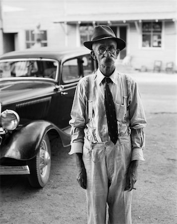1930s PORTRAIT OF OLD MAN WEARING HAT GLASSES TIE & SUSPENDERS CAR IN BACKGROUND Stock Photo - Rights-Managed, Code: 846-05647969