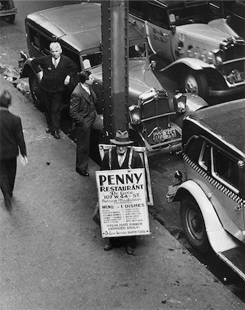 restaurant new york manhattan - 1930s NYC STREET DURING DEPRESSION WITH MAN WEARING SANDWICH BOARD ADVERTISING PENNY RESTAURANT Stock Photo - Rights-Managed, Code: 846-05648034