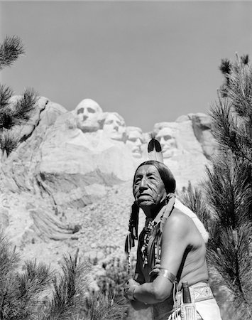 1960s PORTRAIT OF AMERICAN INDIAN IN FRONT OF MOUNT RUSHMORE Stock Photo - Rights-Managed, Code: 846-05648058
