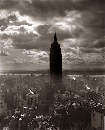 silhouette black and white - 1930s - 1940s EMPIRE STATE BUILDING NEW YORK CITY IN STORM CLOUD COVER Stock Photo - Rights-Managed, Code: 846-05648079