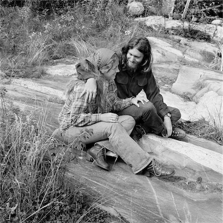 1960s - 1970s ROMANTIC YOUNG HIPPIE COUPLE SITTING OUTDOORS Stock Photo - Rights-Managed, Code: 846-05648073
