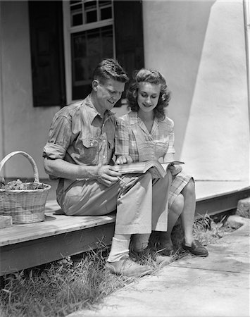 1940s MAN WOMAN SITTING ON PORCH OF FARMHOUSE READING CATALOG Stock Photo - Rights-Managed, Code: 846-05648120