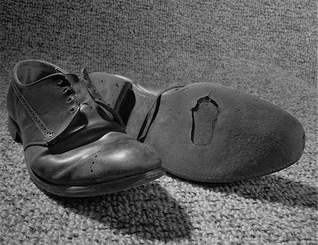 1960s OLD SHOES WELL WORN WITH HOLE IN THE SOLE Stock Photo - Rights-Managed, Code: 846-05648175