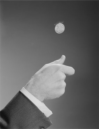 1960s MALE HAND TOSSING FLIPPING A COIN Stock Photo - Rights-Managed, Code: 846-05648187