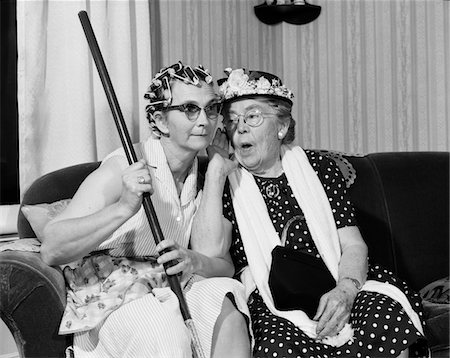 1950s - 1960s TWO ELDERLY WOMEN CHARACTERS GOSSIPING ONE WOMAN WITH HAIR CURLERS OTHER WITH HAT Stock Photo - Rights-Managed, Code: 846-05648207