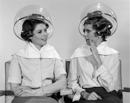 retro beauty salon images - 1960s TWO WOMEN SITTING TOGETHER GOSSIPING UNDER HAIRDRESSER HAIR DRYER Stock Photo - Rights-Managed, Code: 846-05648222