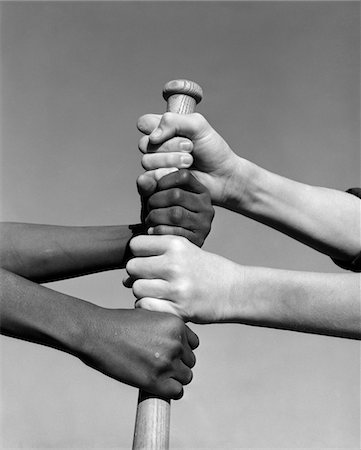 right - 1960s AFRICAN-AMERICAN AND CAUCASIAN HANDS GRIPPING BASEBALL BAT Stock Photo - Rights-Managed, Code: 846-05648265