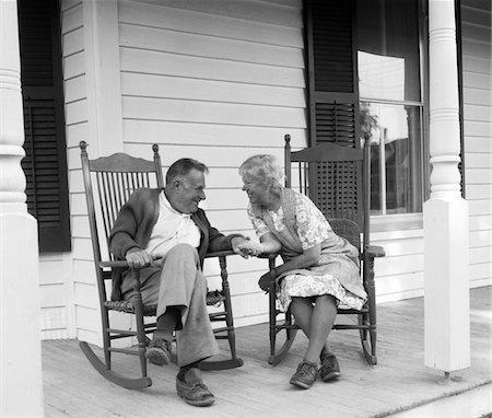 simsearch:846-02793283,k - 1970s ELDERLY COUPLE IN ROCKING CHAIRS ON PORCH HOLDING HANDS Stock Photo - Rights-Managed, Code: 846-05648299