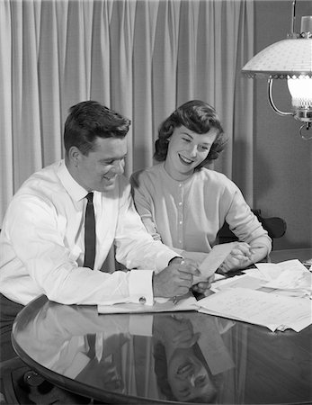 1950s COUPLE HUSBAND WIFE DINING TABLE GOING OVER HOUSEHOLD ACCOUNTS Stock Photo - Rights-Managed, Code: 846-05648311