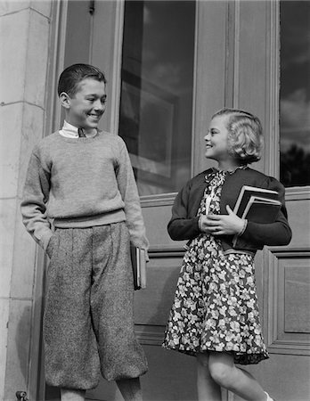 1940s SMILING BOY & GIRL HOLDING SCHOOL BOOKS BY DOORS Stock Photo - Rights-Managed, Code: 846-05648351
