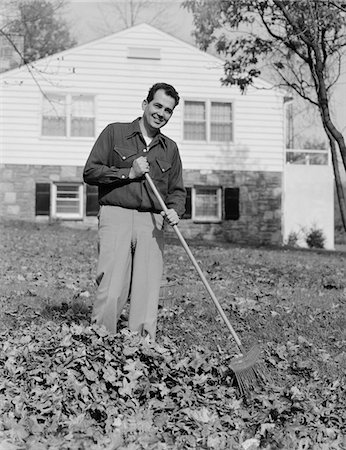 1950s - 1960s SMILING MAN RAKING AUTUMN LEAVES IN FRONT YARD OF HOUSE Stock Photo - Rights-Managed, Code: 846-05648352
