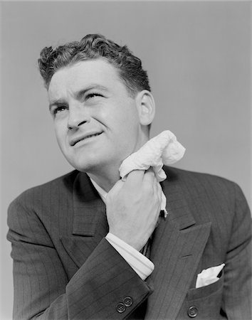 sweaty businessman - 1930s - 1940s MAN UNCOMFORTABLE GRIMACE SWEATING WIPING NECK WITH HANDKERCHIEF Stock Photo - Rights-Managed, Code: 846-05648386