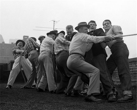 simsearch:846-02793283,k - 1950s MEN PLAYING TUG-OF-WAR Stock Photo - Rights-Managed, Code: 846-05648380