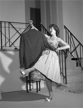 1960s WOMAN IN COCKTAIL DRESS DANCING WITH MAN'S EMPTY JACKET Stock Photo - Rights-Managed, Code: 846-05648381