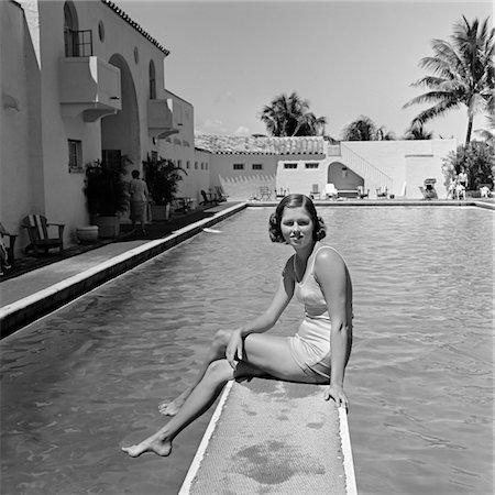 1930s WOMAN ON POOL DIVING BOARD PALM TREE Stock Photo - Rights-Managed, Code: 846-05648420