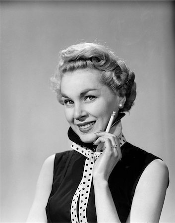 1950s SMILING BLONDE WOMAN POLKA DOT NECK TIE HOLDING CIGARETTE Stock Photo - Rights-Managed, Code: 846-05648501