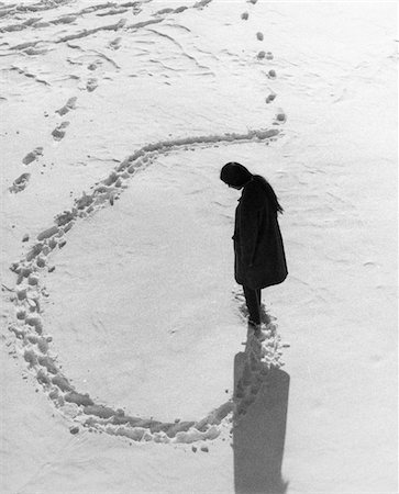 1970s OVERHEAD VIEW OF WOMAN MAKING CIRCULAR TRACKS IN WINTER SNOW OUTDOOR Stock Photo - Rights-Managed, Code: 846-05648524
