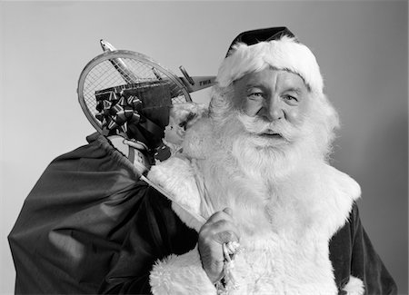 1960s PORTRAIT OF SMILING SANTA CLAUS WITH SACK OF CHRISTMAS TOY PRESENTS SLUNG OVER HIS SHOULDER Stock Photo - Rights-Managed, Code: 846-05648549