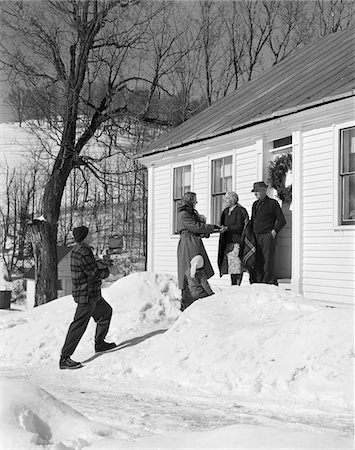 1950s FAMILY VISITING RELATIVES AT CHRISTMAS BEING GREETED AT FRONT DOOR Stock Photo - Rights-Managed, Code: 846-05648560
