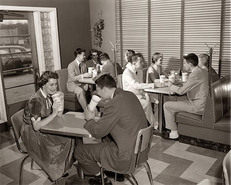 simsearch:846-02793283,k - 1950s MALT SHOP INTERIOR WITH TEENS AT BOOTHS DRINKING FROM DIXIE CUPS Stock Photo - Rights-Managed, Code: 846-06111806
