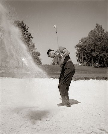 1960s MAN PLAYING GOLF CHIPPING GOLF BALL OUT OF A SAND TRAP OUTDOOR Stock Photo - Rights-Managed, Code: 846-06111854
